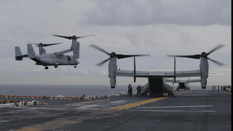 US military searching for three missing marines after Osprey aircraft crashed off Queensland coast.
