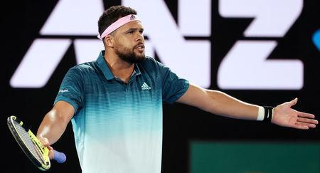 Tennis - Australian Open - Second Round - Melbourne Park, Melbourne, Australia, January 17, 2019. France's Jo-Wilfried Tsonga reacts during the match against Serbia's Novak Djokovic. REUTERS/Lucy Nicholson