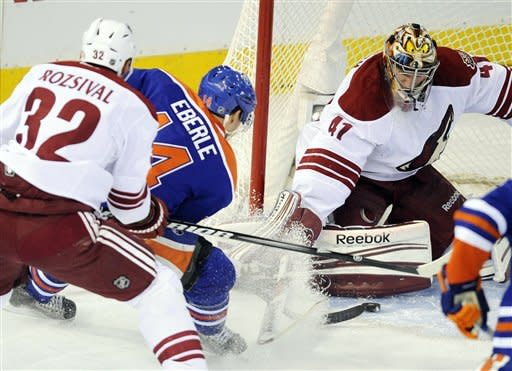 Phoenix Coyotes' Michal Rozsival (32) defends goalie Mike Smith against the Edmonton Oilers' Jordan Eberle, center, during the first period of an NHL hockey game in Edmonton, Alberta, on Saturday, Feb. 25, 2012. (AP Photo/The Canadian Press, John Ulan)