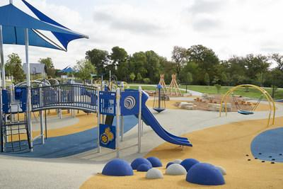 The opening of Liberty Playground, a universally accessible playground that allows children with and without disabilities to play together in a variety of outdoor experiences; Unveiled by Liberty Mutual Insurance and the City of Plano, TX, at Windhaven Meadows Park. (Cooper Neill/Getty Images)