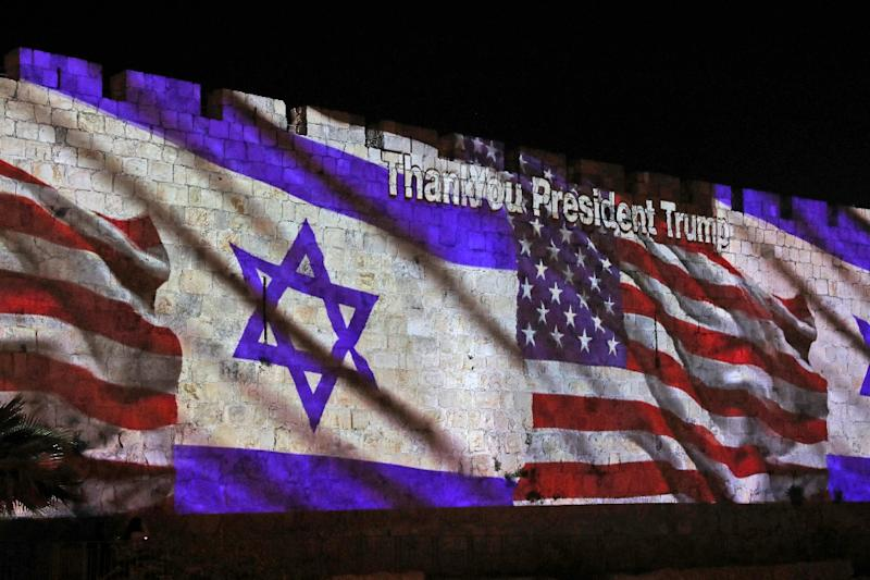 The Israeli and United States flags are projected on the walls of the ramparts of Jerusalem's Old City, to mark the opening of the new US embassy on May 14, 2018 (AFP Photo/Ahmad GHARABLI)