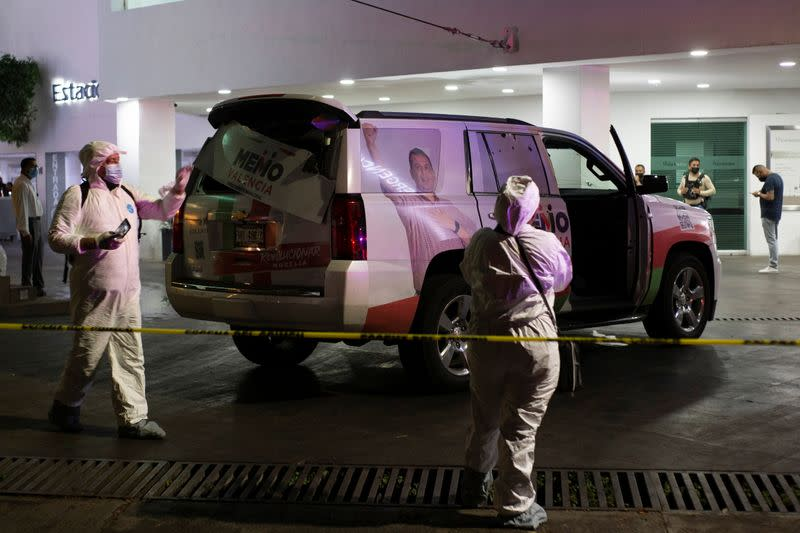 Forensic technicians work at a scene where unknown assailants attacked the truck of the campaign team of Guillermo Valencia, in Morelia