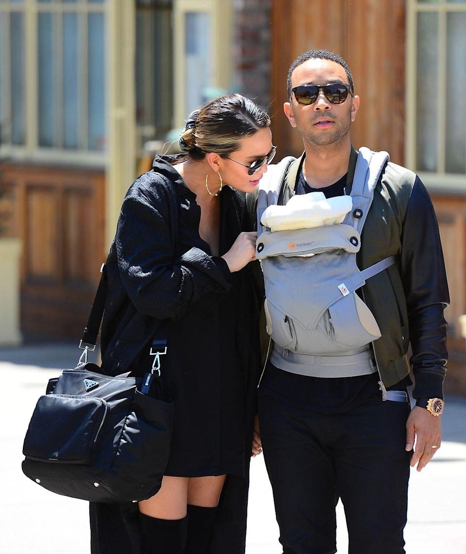 <p>Legend was photographing carrying the couple's one-month-old daughter Luna in a papoose around New York.</p>