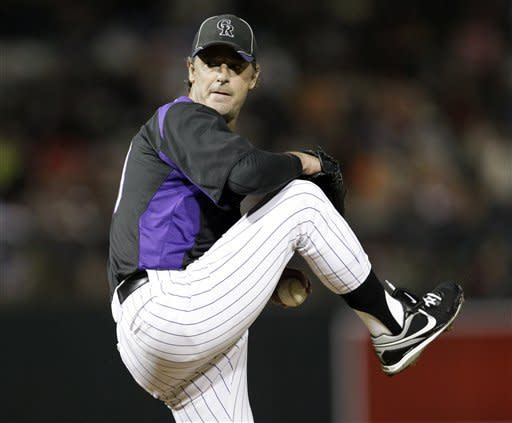 Colorado Rockies starting pitcher Jamie Moyer winds up to throw to the San Francisco Giants during the second inning of a spring training baseball game Thursday, March 22, 2012, in Scottsdale, Ariz. (AP Photo/Marcio Jose Sanchez)