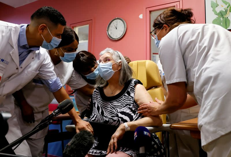 Mauricette, a 78-year-old French woman, receives the first dose of the Pfizer-BioNTech COVID-19 vaccine in the country, in Sevran