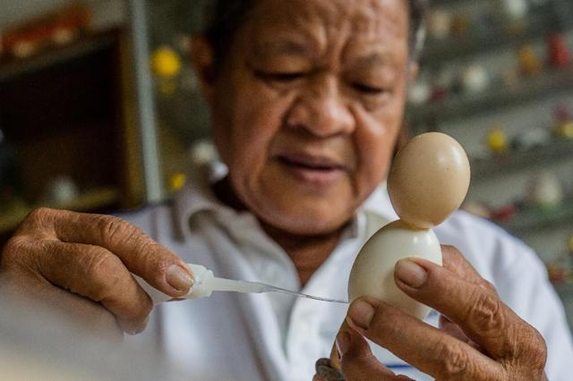 Tam says the biggest challenge is finding the right egg shape to fit the creation (AFP Photo/Thanh NGUYEN)