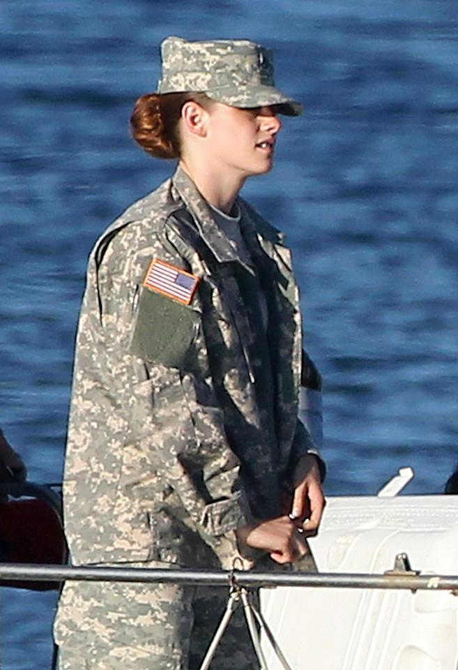 Kristen Stewart, dressed in full military uniform, films scenes for her upcoming movie 'Camp X-Ray' in Los Angeles