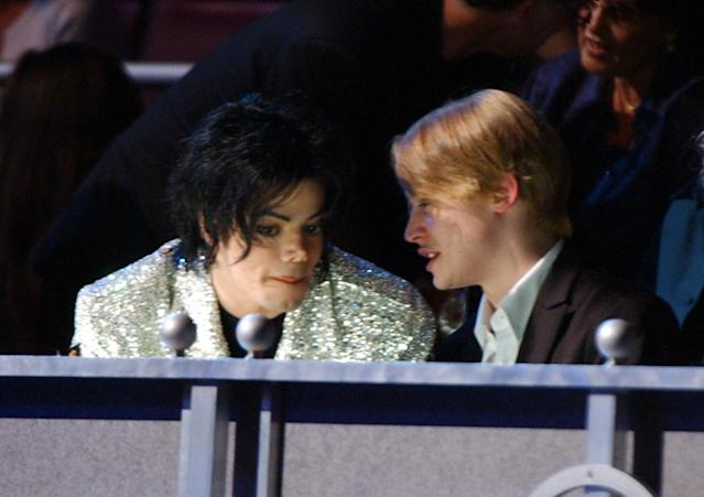 Michael Jackson and Macaulay Culkin at the Madison Square Garden in New York City, New York (Photo by Kevin Kane/WireImage)