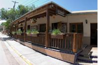 """<p>This <a href=""""https://www.tripadvisor.com/Restaurant_Review-g60958-d459713-Reviews-El_Farol_Restaurant-Santa_Fe_New_Mexico.html"""" rel=""""nofollow noopener"""" target=""""_blank"""" data-ylk=""""slk:Santa Fe spot"""" class=""""link rapid-noclick-resp"""">Santa Fe spot</a> has been around since 1835, and it's still going strong. The rustic wood interior hosts hungry guests for Spanish tapas, live music, and flamenco shows.</p>"""