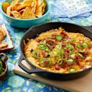"""<p>Just like classic jalapeño poppers, this party dip variation is creamy, cheesy, and deliciously smoky. But best of all—it's ready in just 30 minutes! </p><p><strong><a href=""""https://www.thepioneerwoman.com/food-cooking/recipes/a37150314/jalapeno-popper-dip-recipe/"""" rel=""""nofollow noopener"""" target=""""_blank"""" data-ylk=""""slk:Get the recipe."""" class=""""link rapid-noclick-resp"""">Get the recipe.</a> </strong></p>"""