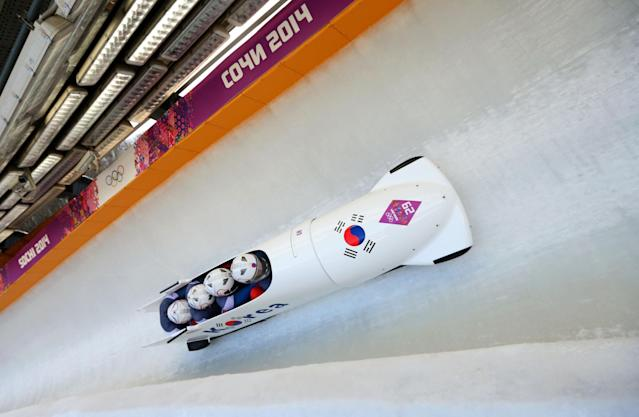SOCHI, RUSSIA - FEBRUARY 23: Pilot Donghyun Kim, Sik Kim, Kyunghyun Kim and Jeahan Oh of Korea team 2 make a run during the Men's Four Man Bobsleigh on day 16 of the Sochi 2014 Winter Olympics at Sliding Center Sanki on February 23, 2014 in Sochi, Russia. (Photo by Mike Ehrmann/Getty Images)