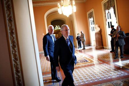 U.S. Senate Majority Leader Mitch McConnell (R-KY) walks to speak to reporters after the weekly Republican caucus policy luncheon at the U.S. Capitol in Washington