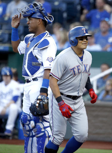 Texas Rangers' Shin-Soo Choo heads back to the dugout after hitting a solo home run during the first inning of a baseball game against the Kansas City Royals Monday, June 18, 2018, in Kansas City, Mo. (AP Photo/Charlie Riedel)