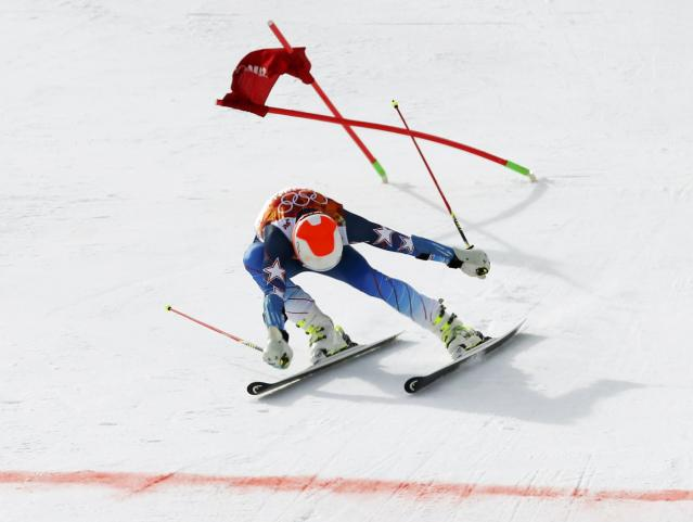 Bode Miller of the U.S. lunges towards the finish line during the first run of the men's alpine skiing giant slalom event in the Sochi 2014 Winter Olympics at the Rosa Khutor Alpine Center