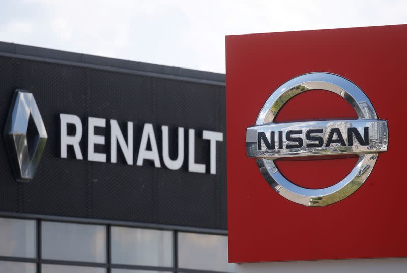 FILE PHOTO: The logos of car manufacturers Nissan and Renault are pictured at a dealership Kyiv