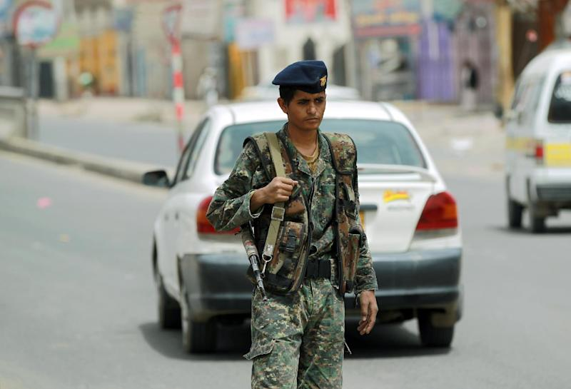 A Yemeni soldier mans a checkpoint at an entrance in Sanaa leading to Amran province, on July 7, 2014