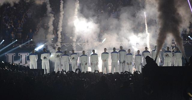 The Kentucky men's basketball team is introduced for the NCAA college basketball team's Big Blue Madness, Friday, Oct. 18, 2013, in Lexington, Ky.(AP Photo/Timothy D. Easley)
