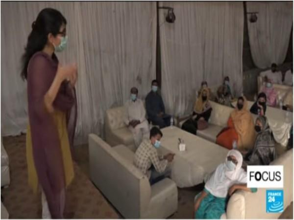 A COVID-19 vaccination awareness campaign held in Lahore (Photo Credit - France24)