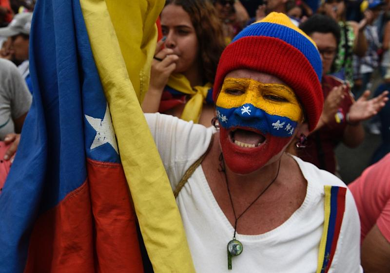 A Guaido supporter awaits the opposition leader's arrival at a rally in Los Teques, in Venezuela's Miranda state (AFP Photo/Federico PARRA)