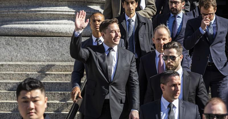 Elon Musk, chief executive officer of Tesla Inc., waves while departing from federal court in New York, U.S., on Thursday, April 4, 2019.