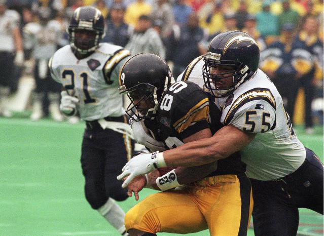 Hall of Fame linebacker Junior Seau, right, was found to have CTE after his death in 2012. Researchers have found strong evidence that repetitive hits to the head, not just concussion, lead to CTE. (AP)