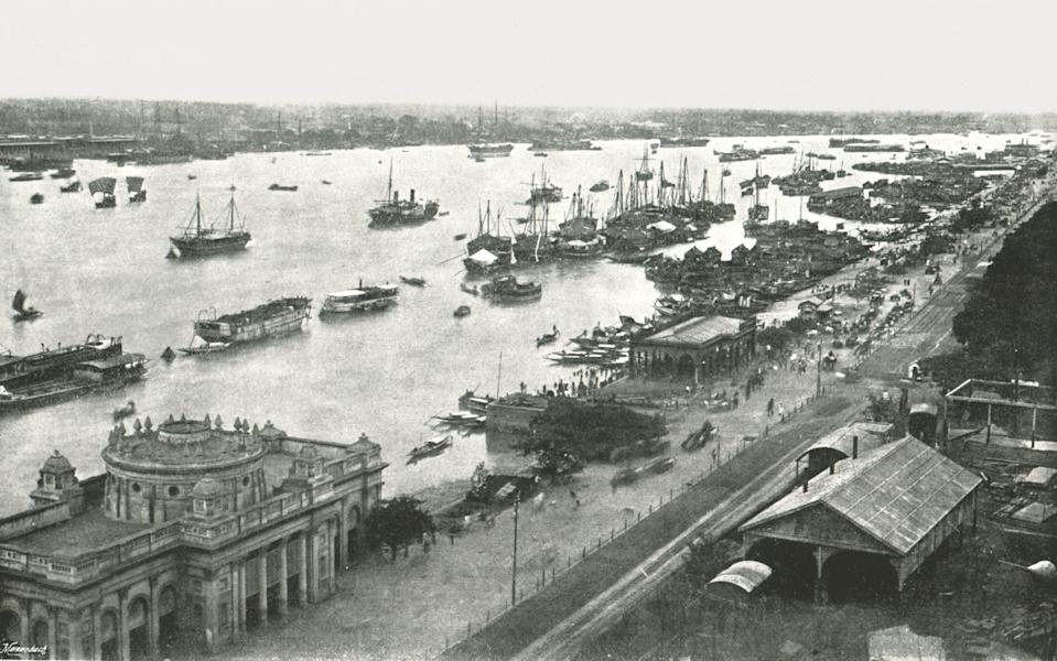 """Calcutta, view from the Hooghly Bridge, 1895. Ships on the river Hooghly at the port of Kolkata, Bengal. From """"Round the World in Pictures and Photographs: From London Bridge to Charing Cross via Yokohama and Chicago"""". [George Newnes Ltd, London, 1895]"""