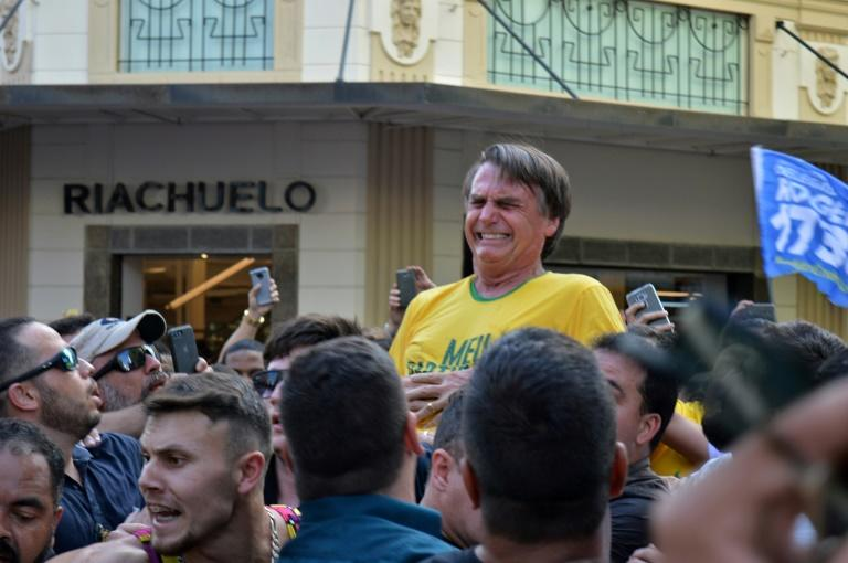 Brazilian right-wing presidential candidate Jair Bolsonaro gestures after being stabbed in the stomach during a campaign rally in southern Brazil
