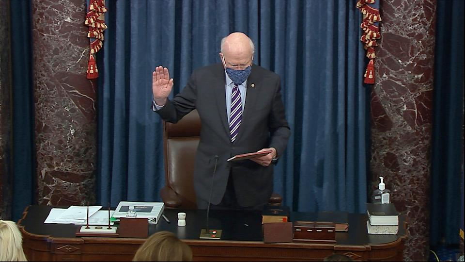 In this image from video, Sen. Patrick Leahy, D-Vt., the president pro tempore of the Senate, who will preside over the impeachment trial of former President Donald Trump, swears in members of the Senate for the impeachment trial against former President Donald Trump in the Senate at the U.S. Capitol in Washington, Tuesday, Jan. 26, 2021. (Senate Television via AP)