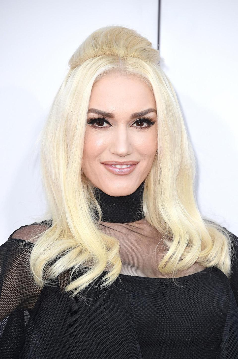 <p>Stefani channeled Priscilla Presley with a '60s beehive style that definitely involved a lot of teasing and possibly required some fake hair.<i> (Photo: Getty Images)</i></p>