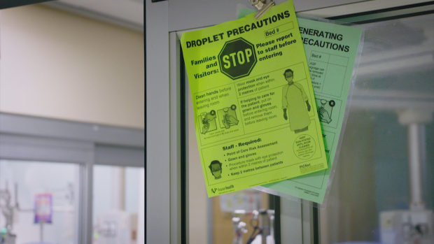 A flyer reminds visitors and staff at Royal Columbian Hospital, in New Westminster, B.C., to take precautions to prevent the spread of COVID-19.