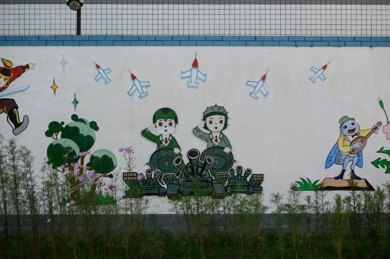 A cartoon is displayed on the wall of a kindergarten, during a guided tour for visiting foreign media in Pyongyang on September 7, 2018