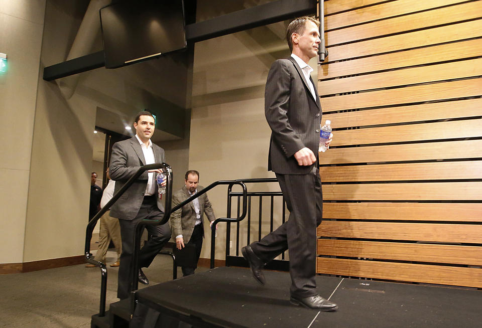 San Francisco 49ers owner Jed York, left, and general manager Trent Baalke, right, arrive to speak at a news conference at 49ers football headquarters in Santa Clara, Calif., on Monday, Dec. 29, 2014. (AP Photo/Tony Avelar)