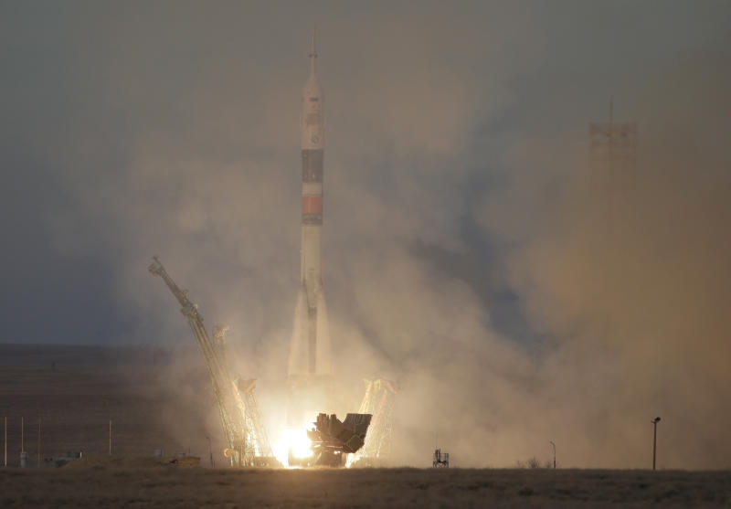 Soyuz spacecraft carrying three astronauts successfully docks with the International Space Station