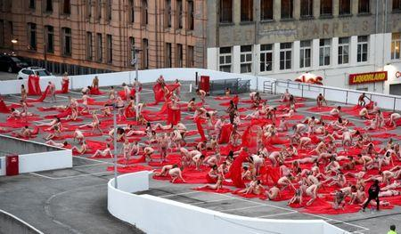 Contemporary New York artist Tunick is seen photographing nude Melburnians in Melbourne