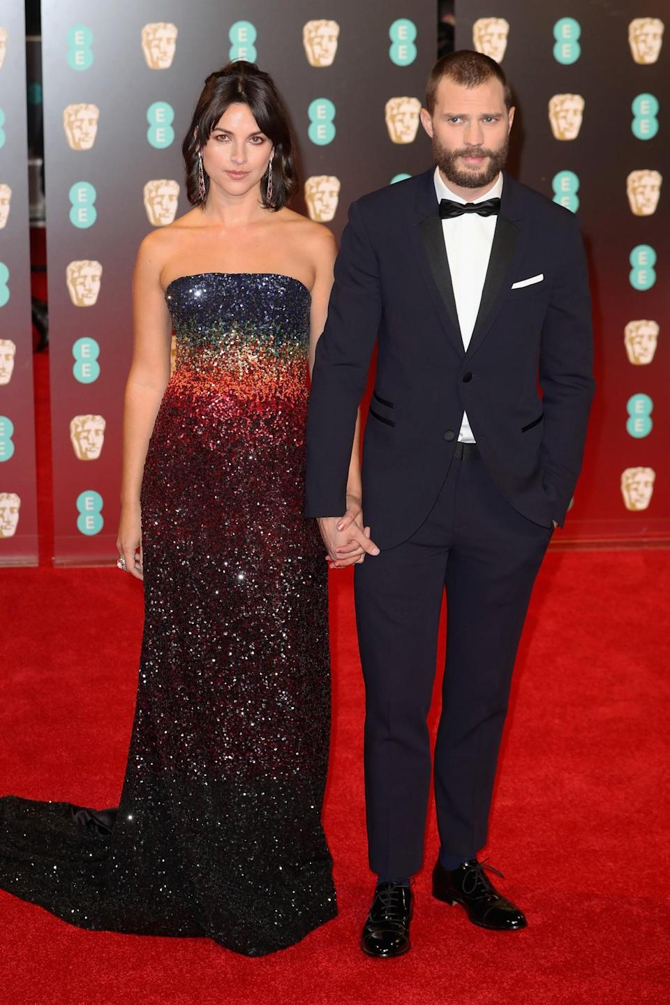 <p>Amelia's glittering ombre gown was a sheer delight while Jamie looked a true gentleman in a Neil Barrett tux. <i>[Photo: Getty]</i> </p>