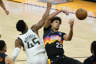 Phoenix Suns forward Cameron Johnson (23) battles Utah Jazz guard Donovan Mitchell (45) for the ball during the second half of an NBA basketball game, Wednesday, April 7, 2021, in Phoenix. (AP Photo/Matt York)