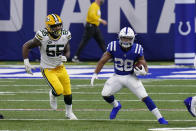 Indianapolis Colts' Jonathan Taylor (28) is chased by Green Bay Packers' Za'Darius Smith (55) during the second half of an NFL football game, Sunday, Nov. 22, 2020, in Indianapolis. (AP Photo/AJ Mast)