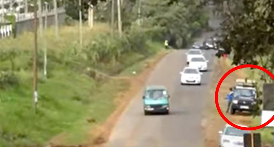 A police vehicle at a site where they were led to in the search for victim's bodies. Source: Kenya Citizen TV