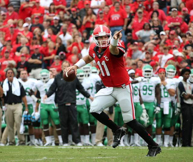 Georgia quarterback Aaron Murray (11) rolls out of the pocket before he throws an interception in the end zone in the first half of an NCAA college football game against North Texas at Sanford Stadium Saturday, Sept. 21, 2013, in Athens, Ga. (AP Photo/Atlanta Journal-Constitution, Jason Getz )