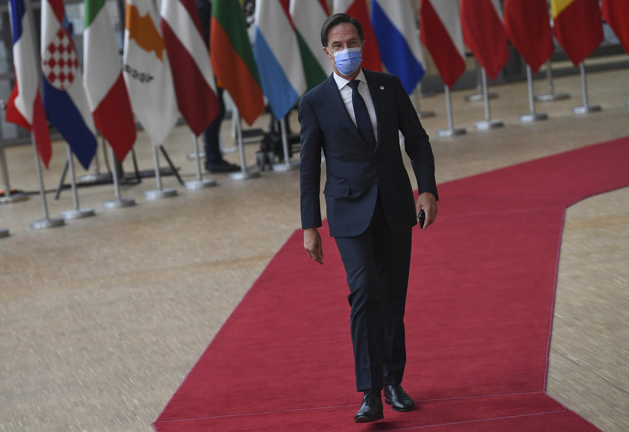 Dutch Prime Minister Mark Rutte arrives for an EU summit at the European Council building in Brussels, Thursday, June 24, 2021. At their summit in Brussels, EU leaders are set to take stock of coronavirus recovery plans, study ways to improve relations with Russia and Turkey, and insist on the need to develop migration partners with the countries of northern Africa, but a heated exchange over a new LGBT bill in Hungary is also likely. (John Thys, Pool Photo via AP)