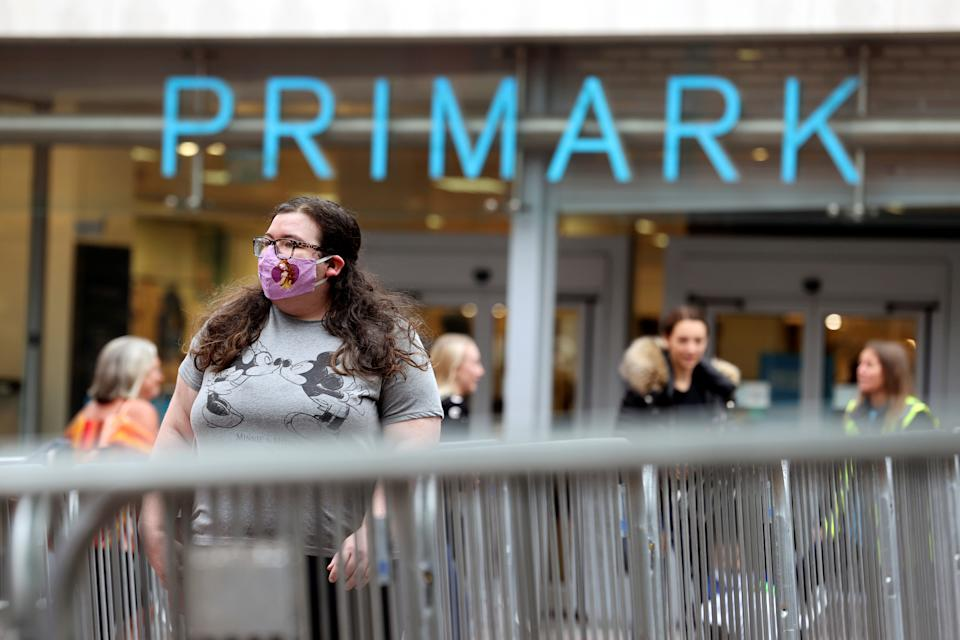 People queue outside a Primark store, after the branch's reopening amid the coronavirus disease (COVID-19) in Hanley, Britain June 15, 2020. REUTERS/Carl Recine