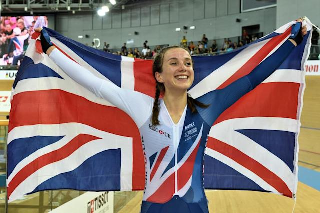 Britain's Elinor Barker holds the Union Jack after winning the points race final during the Track Cycling World Championships in Hong Kong, on April 16, 2017 (AFP Photo/Jayne Russell)