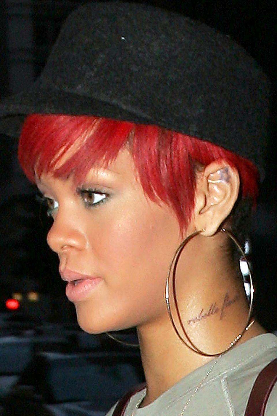 """<p>Rihanna wanted the phrase """"<a href=""""https://www.bustle.com/articles/146118-11-celebrities-with-tattoos-that-have-mistakes-photos"""" rel=""""nofollow noopener"""" target=""""_blank"""" data-ylk=""""slk:rebellious flower"""" class=""""link rapid-noclick-resp"""">rebellious flower</a>,"""" inked in French on her neck—but unfortunately, she must not have realized that the noun goes <em>before</em> the adjective in that language. The words """"rebelle fleur,"""" actually mean """"flower rebel."""" <br></p>"""