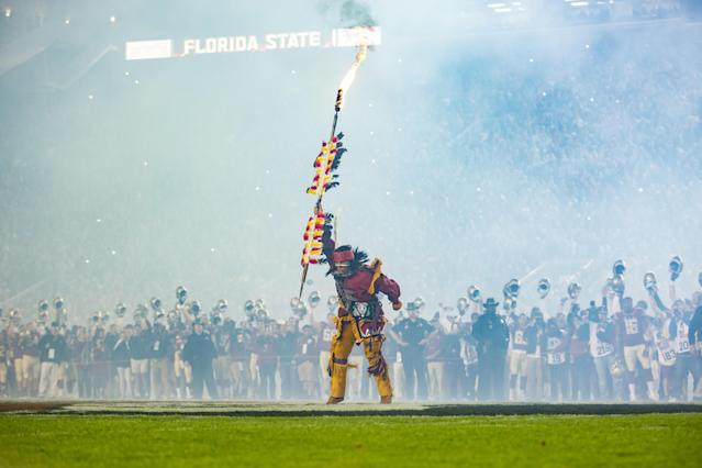 Osceola raises the spear for the crowd before he plants it a midfield for the NCAA football game between the Florida State Seminoles and the Florida Gators. (Getty Images)