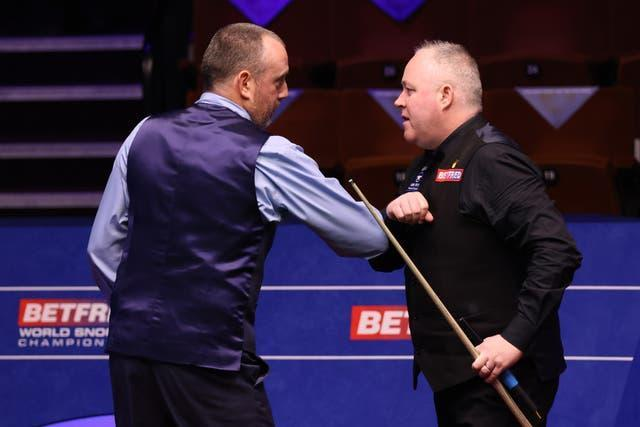 Mark Williams, left, defeated old foe John Higgins with a session to spare
