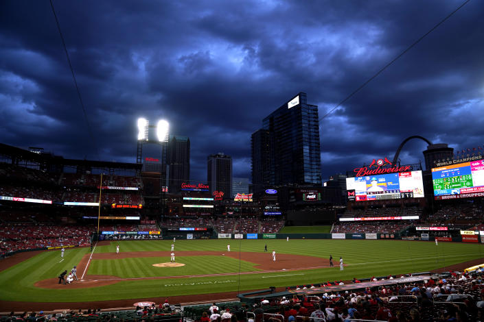 Clouds hang over Busch Stadium as the St. Louis Cardinals play the New York Mets during the third inning of a baseball game Monday, May 3, 2021, in St. Louis. (AP Photo/Jeff Roberson)