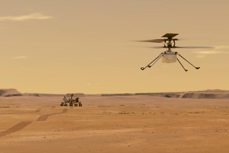 This illustration made available by NASA depicts the Ingenuity helicopter on Mars after launching from the Perseverance rover, background left. It will be the first aircraft to attempt controlled flight on another planet. (NASA/JPL-Caltech via AP)