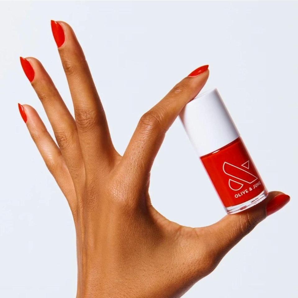 """I packed CV in my carry-on for a pre-corona trip, it's quickly become the most used shade in my arsenal. It's bright without being harsh, and looks great whether I'm pale or have a touch of a tan. Most of all, I love how insanely shiny and opaque the formula is. It leaves my nails photo-ready (everything's a nail prop) in five minutes flat. <em>—B.C.</em> $8, Olive & June. <a href=""""https://oliveandjune.com/collections/nail-polish/products/cv"""" rel=""""nofollow noopener"""" target=""""_blank"""" data-ylk=""""slk:Get it now!"""" class=""""link rapid-noclick-resp"""">Get it now!</a>"""