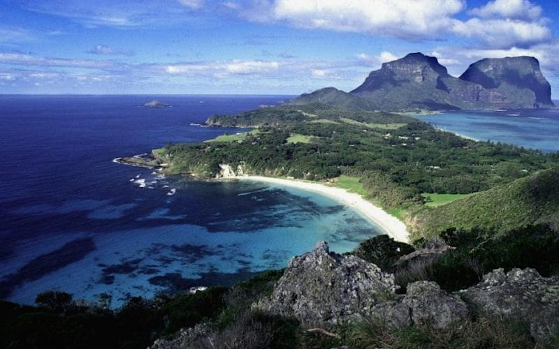 An undated photograph shows the World Heritage protected Lord Howe Island with Ned's Beach in foreground and Mount Lidgbird and Mount Gower behind - Credit: AFP
