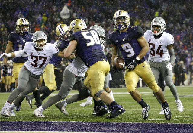 Washington running back Myles Gaskin (9) rushes for a touchdown against Washington State during the second half. It was Gaskin's fourth touchdown of the game. (AP)